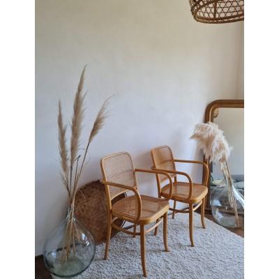 Paire de fauteuils cannés vintage